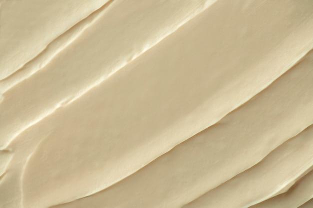 Close-up do fundo com textura de glacê creme