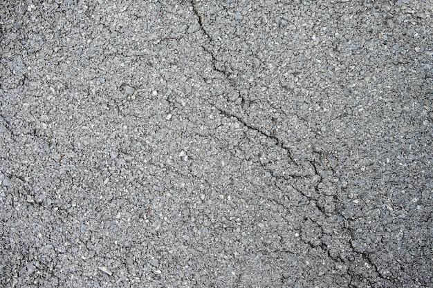 Close up do fundo da textura da estrada asfaltada da rachadura