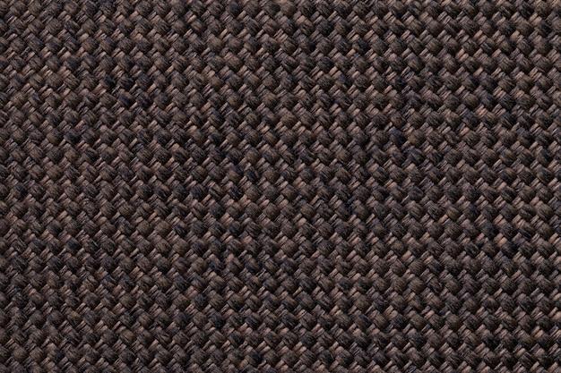 Close up do fundo de matéria têxtil do marrom escuro.