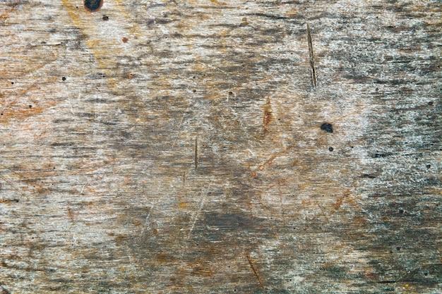 Close up do fundo vintage, copie o espaço. fundo de madeira pintado de cinza. textura granulada de madeira.