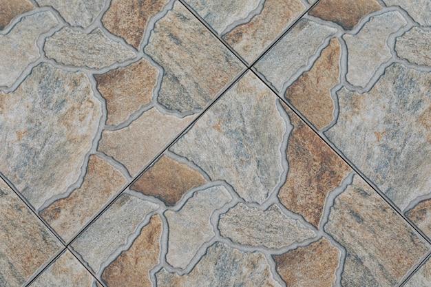 Close-up do piso de cerâmica com padrão de mosaico.