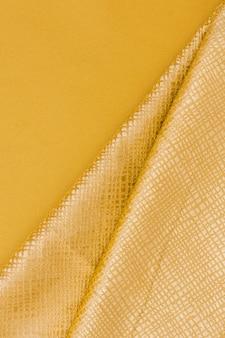 Close-up elegante material dourado