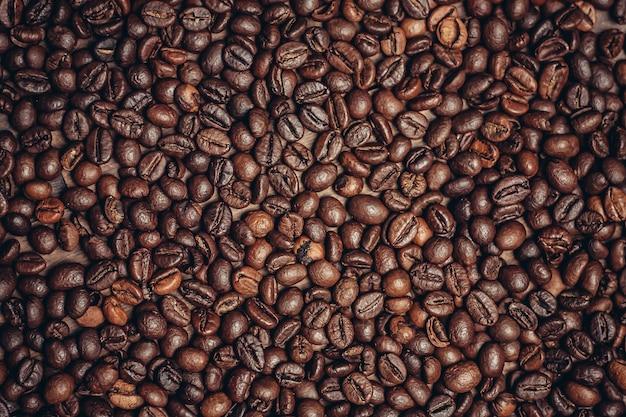 Close-up em grãos torrados de textura de café
