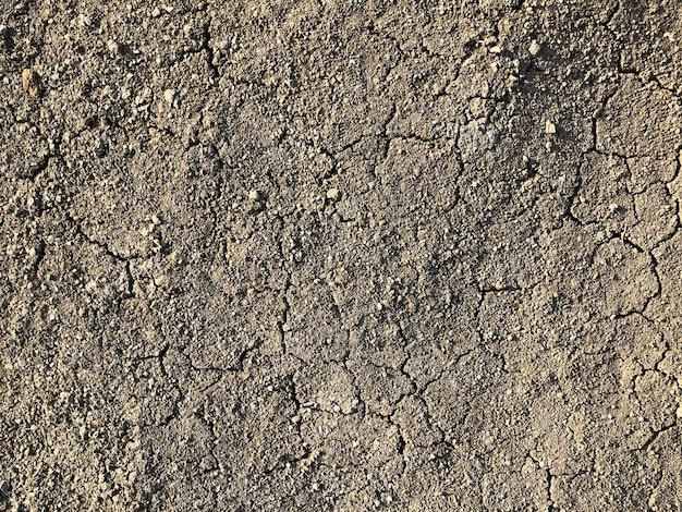 Close-up em lama de terra seca marrom rachada