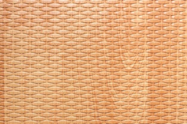 Close up extremo do fundo da textura do rattan de madeira marrom.