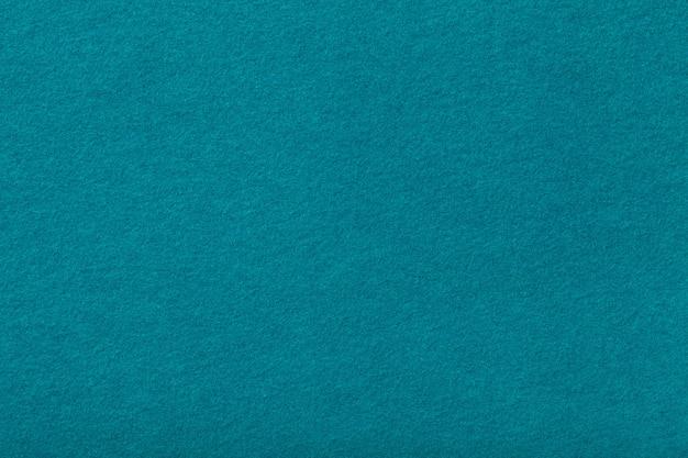 Close up matt da tela da camurça de turquesa escura. textura de veludo de feltro.