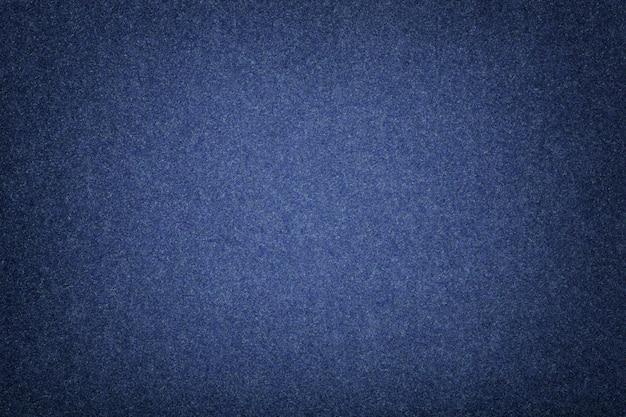 Close up matt da tela da camurça dos azuis marinhos. textura de veludo de feltro.