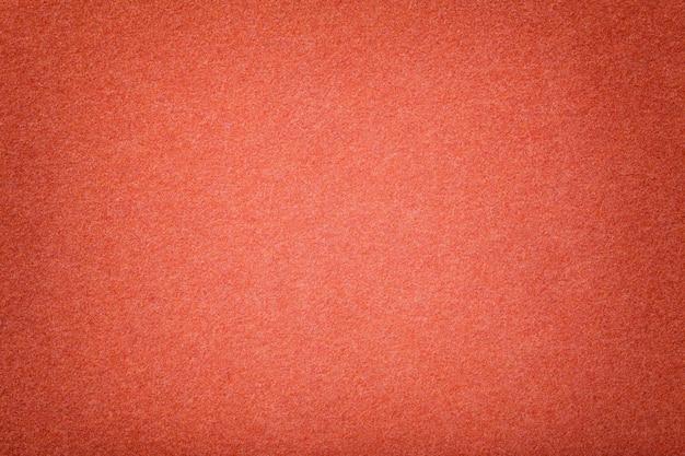 Close up matt escuro da tela da camurça da laranja. textura de veludo de feltro.