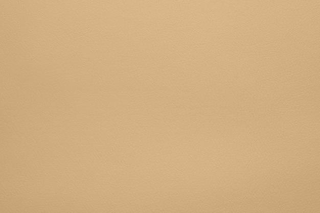 Close-up padrão de textura de fundo de grão de couro natural bege pastel, diretamente acima