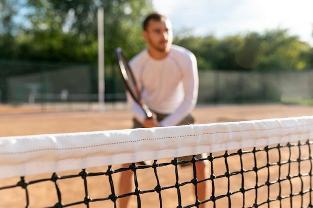 Close-up, rede, com, desfocado, homem joga tênis