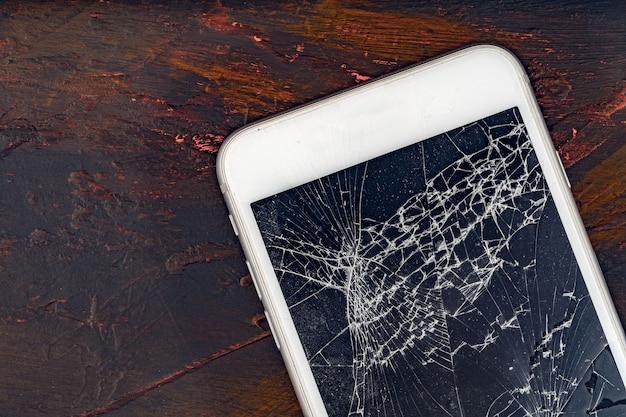 Close-up smartphone móvel com tela quebrada