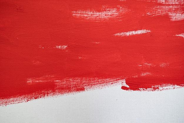 Close up texture pintura de cor vermelha em tela de cor branca traço de marcas de pincel para design gráfico de papel no fundo