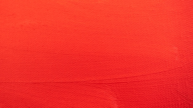 Close up texture pintura de cor vermelha na tela o pincel marca o traço para design gráfico de papel no fundo