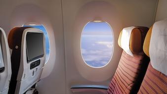 Closeup a janela do avião de passageiros