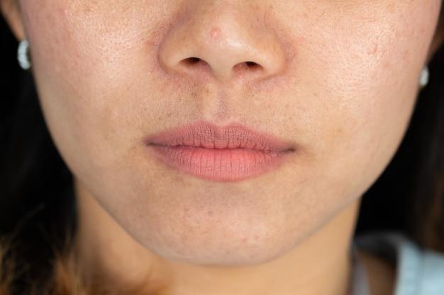Closeup boca de mulher, lábio de menina, mulher asiática