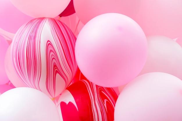 Closeup de balões cor de rosa. abstrato. festa de celebração e cenário de decoração.