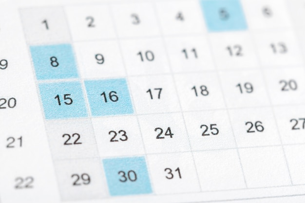 Closeup de datas na página do calendário