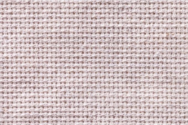 Closeup de fundo branco têxtil. estrutura da macro de malha
