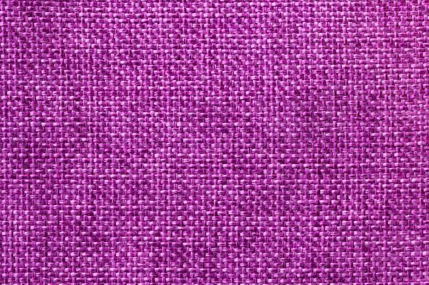 Closeup de fundo roxo têxtil. estrutura da macro de tecido