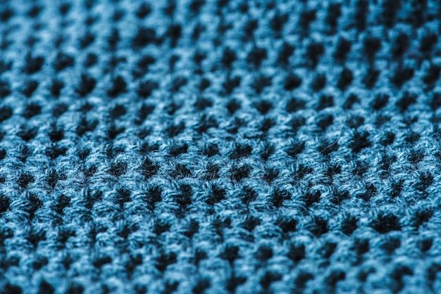 Closeup de macro de textura têxtil de lã azul