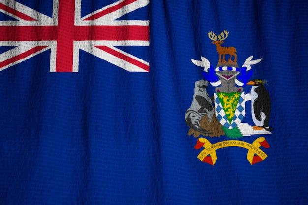 Closeup de ruffled geórgia do sul e as ilhas sandwich do sul bandeira,