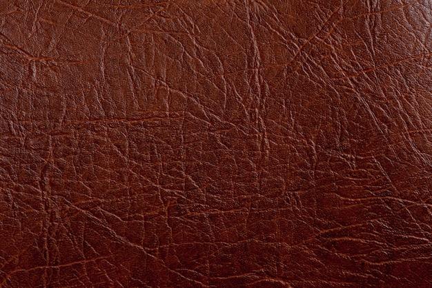 Closeup de textura de couro marrom. útil como pano de fundo para trabalhos de design.