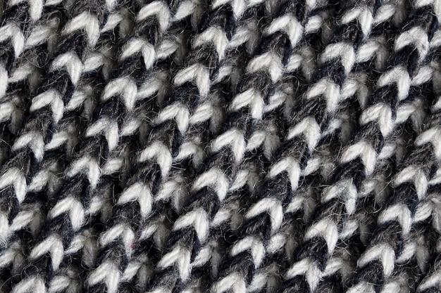 Closeup de textura de lã tricotada preto e branco