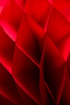 Closeup detalhe do favo de mel vermelho pom-pom papel bola decoração