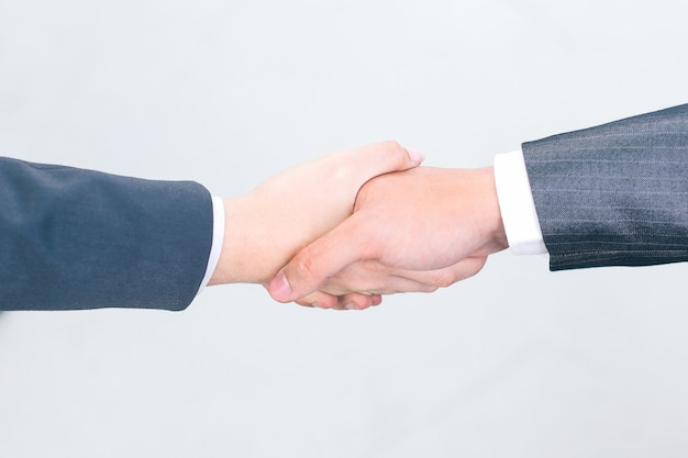 Closeup.os parceiros de negócios do aperto de mão. .o conceito de parceria.