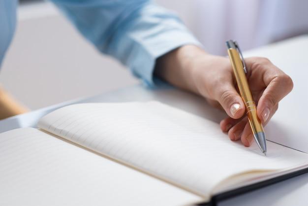 Closeup, pessoa, fazer, notas, caderno