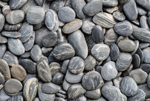 Closeup piso de pedra preta bonita para decoração no jardim texturizado fundo
