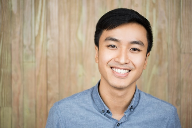 Closeup portrait of smiling handsome asian man