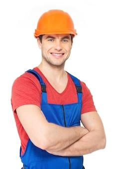 Closeup retrato de trabalhador feliz de uniforme isolado no branco