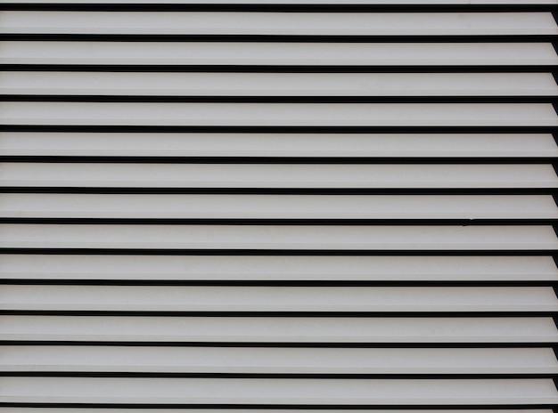 Closeup tiro ao ar livre de persianas de metal como pano de fundo