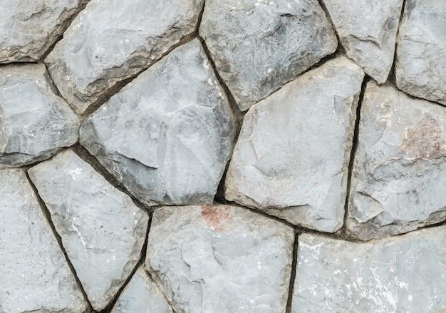 Closeup velho muro de pedra no fundo de textura de jardim