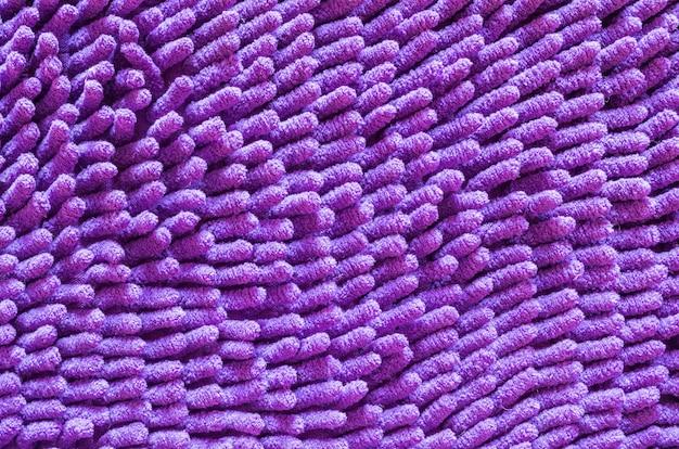 Closeup velho tapete roxo textura de fundo