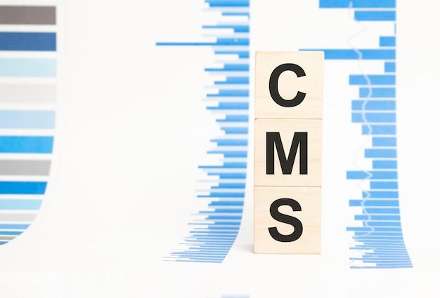 Cms assina no conceito de cubos de madeira, cubos de madeira.