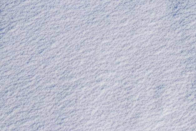 Cobertura de neve uniforme. textura de neve em um terreno plano