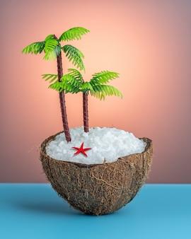Coco tropical e palmeira na mesa azul