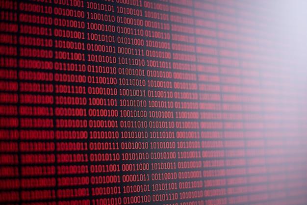 Código binário vermelho na tela do computador. informação, dados, ciência, informática
