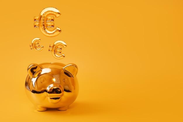 Cofrinho dourado sobre fundo amarelo com balões de ouro euro. símbolo de moeda dourada feito de balão inflável de folha. conceito de investimento e bancário. economia de dinheiro, caixa de dinheiro, finanças, investimentos