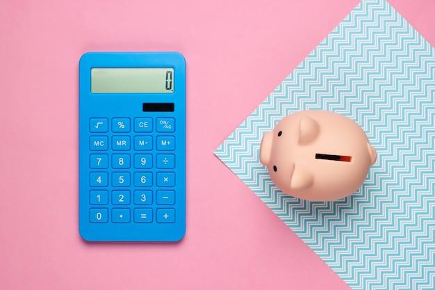 Cofrinho e calculadora em rosa azul