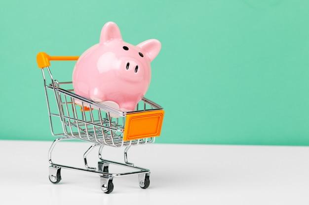 Cofrinho rosa com carrinho de compras