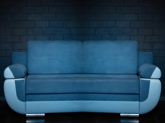 Colagem de fotos abstratas de sofá azul em fundo de parede de tijolo preto.