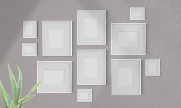 Colagem de quadros em branco em uma maquete de parede renderização em 3d
