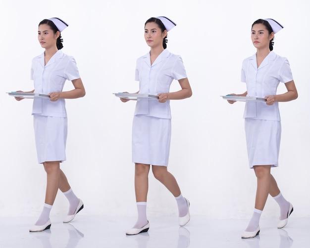 Colagem grupo comprimento total figura snap dos anos 20 mulher asiática usa uniforme e sapatos brancos da enfermeira. a fêmea segura a bandeja e anda muito estilo sobre o fundo branco isolado