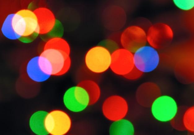 Coleção de fundos - foto colorida de luzes de natal desfocadas à noite