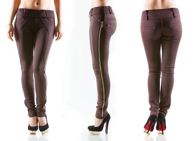 Coleção de pernas femininas em calças skinny clássicas roxas cor de vinho claras e sapatos pretos de salto alto