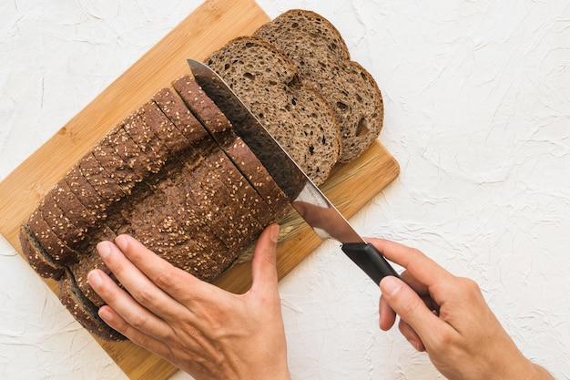 Colheita, mãos, corte, pão