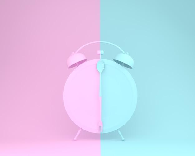 Colher criativa e garfo no prato redondo em forma de despertador no pastel-de-rosa e azul